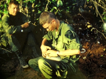 Sergeant Mac and Lt Judd in a foxhole in Vietnam