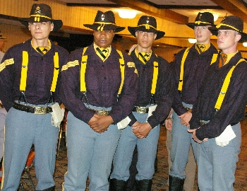 Distinguished honor guard in old horse cavalry uniforms.